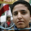 Members of the National Council of Resistance for Iran depict a public hanging